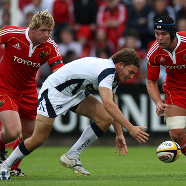 Stephen Archer and Billy Holland in action for Munster