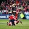 Munster's Mick O'Driscoll and Niall Ronan combine to halt the progress of New Zealand out-half Stephen Donald