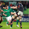 Stephen Ferris, who carried strongly for the men in green, ships a tackle from hard-working American lock Hayden Smith