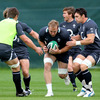 Stephen Ferris is supported by Jerry Flannery and David Wallace as he prepares to set up a ruck during training