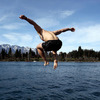 Stephen Ferris shows off his diving skills as he jumps into the lake, which is surrounded by stunning mountains in the southwest corner of Otago