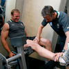 Physiotherapist Cameron Steele assists Stephen Ferris with some stretches during today's weights session in Queenstown