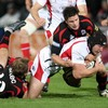 Stephen Ferris, man-of-the-match on the night, is stopped in his tracks by Edinburgh's David Blair and Allister Hogg
