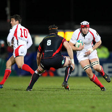 Stephen Ferris takes on Scarlets back rower David Lyons