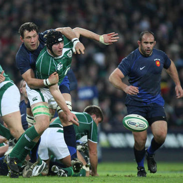 Stephen Ferris offloads in the tackle against France