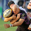 Ospreys winger Richard Fussell loses control of the ball, under pressure from Ulster's Stephen Ferris