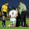 Referee Alain Rolland looks on as Ulster physio Gareth Robinson and doctor David Irwin tend to Stephen Ferris