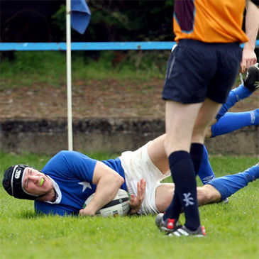 St. Mary's centre Stephen Grissing gets over for a try