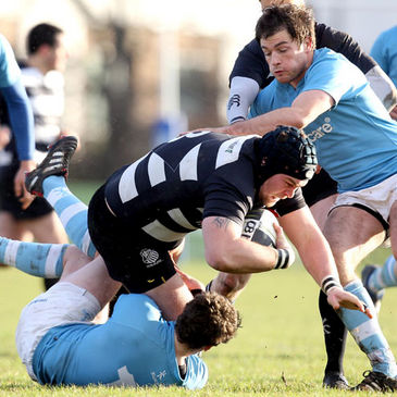 Old Belvedere's Stewart Maguire is tackled by the Garryowen cover
