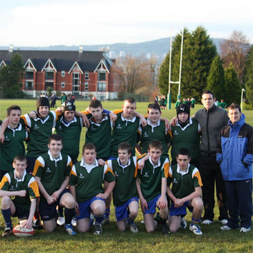 Seamus Mallon with the some of the schoolboys who took part in the match