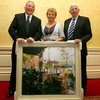 Former IRB Chairman Dr. Syd Millar, accompanied by his wife Enid, is presented with a painting by incoming IRFU President John Lyons