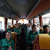 The girls in green are pictured on the team bus as they make their way to the Venegoni Stadium in Parabiago