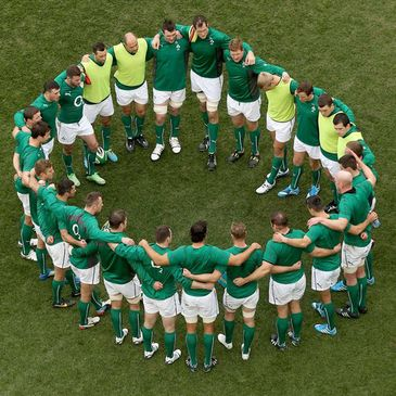 The Ireland players huddle together