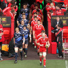 Leinster captain Leo Cullen and Munster captain Paul O'Connell are pictured leading the teams out at a packed-out Thomond Park