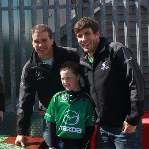 A young fan with Connacht's Thomas Anderson and Eoghan Grace