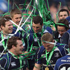 The victorious Leinster players are covered in ticker tape as they celebrate victory in their first Heineken Cup final