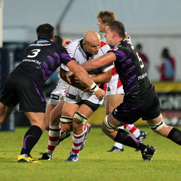 Ulster's Tim Barker takes the ball into contact