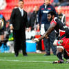 Scarlets coach Nigel Davies looks on as Ulster's Fijian winger Timoci Nagusa tries to keep the ball in play