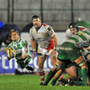 Benetton Treviso scrum half Tobie Botes flies through the air as he fires his pass away from a ruck