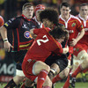 Munster Academy player Mike Sherry, who was making his second league start, puts a tackle in on Toby Faletau