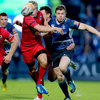 Leinster centre Brian O'Driscoll is held back by Edinburgh's Tom Brown as they compete for possession at the RDS