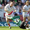 Northampton Saints lock Courtney Lawes tackles Ulster's Tom Court as the sides compete for a place in the Heineken Cup's last four