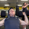 As Donnacha Ryan takes a breather in the background, strongly-built prop Tom Court goes through his weights routine