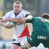 Prop Tom Court, who was ever-present for Ulster during the pool stages, tries to fend off Aironi scrum half Mickey Wilson