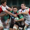 Harlequins replacement Tom Guest is tackled by Ulster's Robbie Diack and Ryan Caldwell