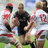 Ospreys winger Tom Isaacs is trackled by Ulster captain Johann Muller and Luke Marshall, who was starting his seventh game for the province