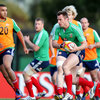 Simon Zebo provides the opposition as fellow Ireland international Tommy Bowe leads an attack during a training game
