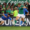Tommy Bowe manages to hack the ball on just ahead of Italy's Andrea Masi, as he goes desperately close to scoring a late try for Ireland