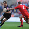 Ireland's Tommy Bowe, who started at outside centre, tries to get around Munster hooker Damien Varley