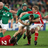 Wales' Huw Bennett and Bradley Davies try to halt the progress of Tommy Bowe, who was one of Ireland's chief attacking threats
