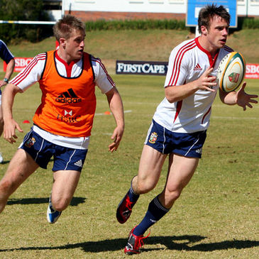 Tommy Bowe takes the ball on at training in Sandton