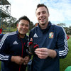 Physiotherapist Prav Mathema is pictured with Tommy Bowe after he bandaged up the winger's gloved right hand before the pitch session at Scotch College