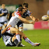 Ulster's returning winger Tommy Bowe gets his pass away under pressure from Cardiff's James Down and Andries Pretorius