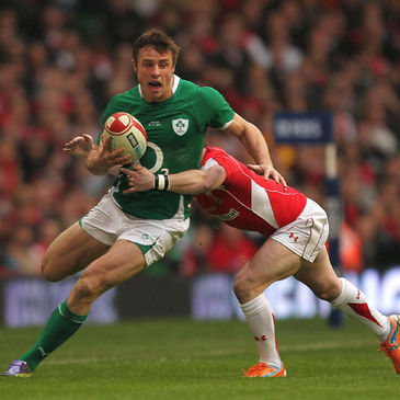 Tommy Bowe takes on his Ospreys colleague Shane Williams