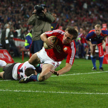 Tommy Bowe dives over for his first try against the Golden Lions