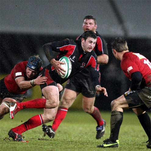 Ulster Ravens winger Tommy Seymour takes the ball on