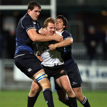 Devin Toner and Ian McKinley tackle Pirates winger Nick Jackson