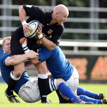Ballymena's Tommy Booth is tackled by the Mary's cover