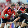 Munster replacement Tony Buckley goes to hand off James Hook during the latter stages of the game