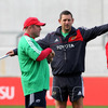 Head coach Tony McGahan and backs coach Jason Holland are pictured during the squad session in Limerick