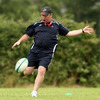 Munster coach Tony McGahan shows off his kicking skills as the players complete their third week of pre-season training