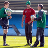 Ireland kicking coach Mark Tainton is pictured in conversation with Andrew Trimble and Conor Murray, who are both hoping to feature in the team to play Italy