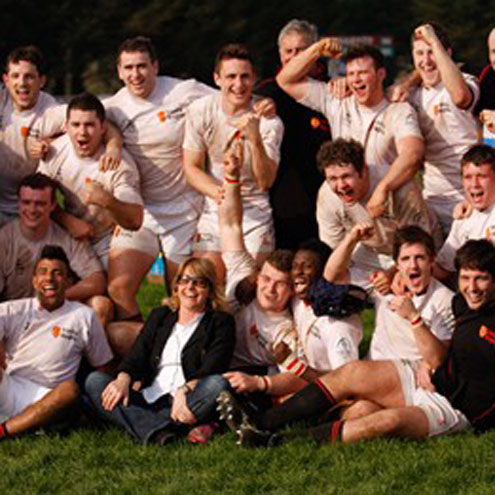 The Trinity College students celebrate with the club's President Kay Bowen