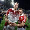 Stand-in captain Alun Wyn Jones holds the cup with Leigh Halfpenny, whose 21-point haul was a new record for a Lions player in a Test match