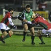 Troy Nathan, one of Connacht's first half try scorers, is double teamed by Portugal's Diogo Gama and Goncalo Da Silva