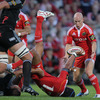 A head over heels Sam Tuitupou succeeds in getting the ball back on the Munster side, with Peter Stringer the recipient